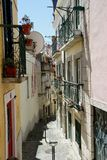 Little alley in Alfama in Lisbon, Portugal Stock Images