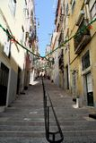 Little alley in Alfama in Lisbon, Portugal Royalty Free Stock Photos