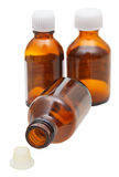 Little amber glass pharmacy bottles with cap Royalty Free Stock Photography