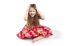 Little amusing girl holding her hands behind her head. Royalty Free Stock Photos
