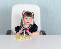 Little amusing girl is playing with toys Stock Photography