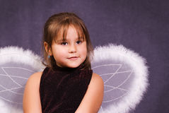 Little Angel. A little girl pretending to be an angel and wearing wings Royalty Free Stock Image