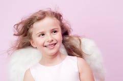 Little Angel. Cute little girl with angel wings Stock Photo
