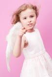 Little Angel. Cute little girl with angel wings Stock Image