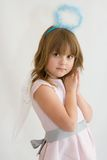 Little angel. Cute, little angel girl with blue aureole Royalty Free Stock Image