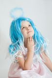Little angel. Cute, little angel girl with blue aureole, on white Royalty Free Stock Photos