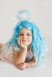 Little angel. Cute, little angel girl with blue aureole, on white Stock Photography