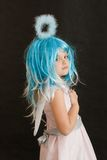 Little angel. Cute, little angel girl with blue aureole, on black Stock Photography