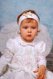 Little angel. Little baby girl with white wings as angel Royalty Free Stock Photography