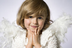 Little angel. Cute little girl with angel wings Royalty Free Stock Image