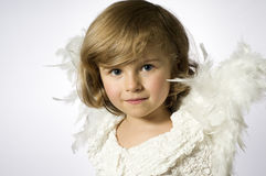 Little angel. Cute little girl with angel wings Stock Photography
