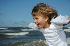 Little angel on the beach Royalty Free Stock Photo