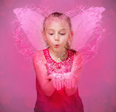 Little angel blowing stars on Valentines Day. Stock Image