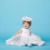 Little angel on blue background Stock Photography