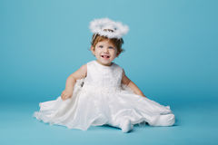 Little angel on blue background Royalty Free Stock Image