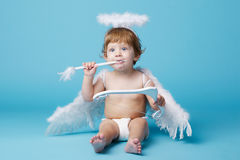 Little angel on blue background Stock Image