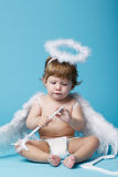 Little angel on blue background Stock Photo