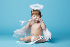 Little angel on blue background Stock Images