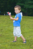 Little angel boy. Little boy in the park with small angel white wings and hearts decoration Royalty Free Stock Photos