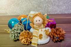 Little Angel Christmas gift boxes among small. Royalty Free Stock Photography