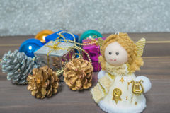 Little Angel Christmas gift boxes among small. On the wooden background Stock Image
