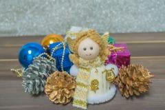 Little Angel Christmas gift boxes among small. Royalty Free Stock Image