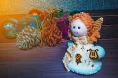 Little Angel Christmas gift boxes among small Stock Photo