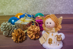 Little Angel Christmas gift boxes among small. On the wooden background Stock Images