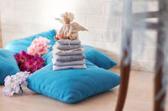 Little angel doll sitting on a pillow. Valentine`s day. Children`s toy hand made Royalty Free Stock Photo
