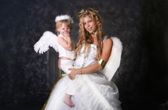 A little Angel Giggle. Angelic Mother and Giggling Son stock image