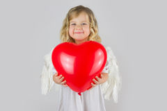 Little angel. Little girl in costume of angel in studio Stock Image