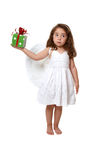 Little angel girl holding a present Royalty Free Stock Photography