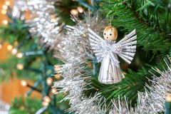 Little angel hanging in Christmas tree Stock Photos