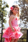 Little Angel in orange dress at Beauty Pageant Stock Photos