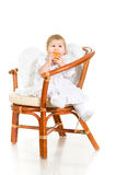 Little angel with orange fruit Stock Photography