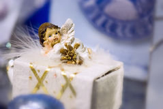 Little angel, ornamentation. Close up picture of a wonderful little angel lying on some surface (gift box or smt): tiny figure of a charming angel, brown hair Stock Images