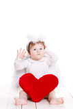 Little angel with red heart isolated on white. Stock Photos