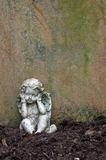 Little angel sculpture decorate in small garden Stock Photos