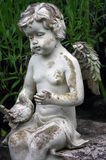 Little angel sculpture decorate in small garden Royalty Free Stock Image