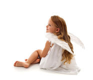 Little angel sitting. Cute girl with long hair and white wings Stock Photos