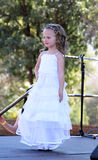 Little Angel in white dress at Beauty Pageant Stock Images