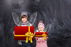 Little angels with gifts Royalty Free Stock Image
