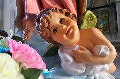 Little angle sculpture and flower in Catholic Church Royalty Free Stock Image