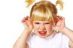 Little angry girl stock photo