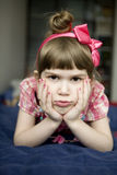 Little angry girl lying on sofa Royalty Free Stock Image