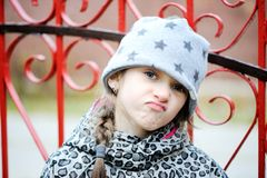 Little angry girl portrait outside Stock Image