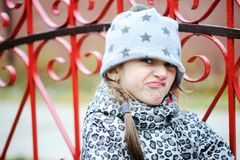 Little angry girl portrait outside Royalty Free Stock Image