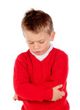 Little angry kid with red jersey Stock Images