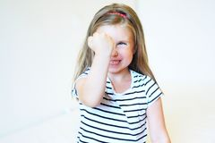 Little angry toddler girl. Portrait of little angry toddler girl Stock Images
