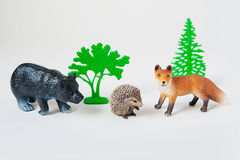 Little animal toys Fox, bear and hedgehog on white background Royalty Free Stock Photo